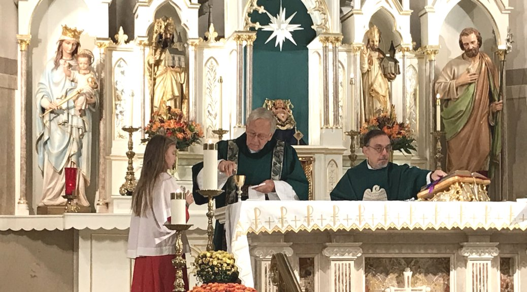 Altar Server Sydney Oscavich, Deacon Steve Gorbos, and Father Dave Kozak at the Incarnation of Our Lord Chuch.