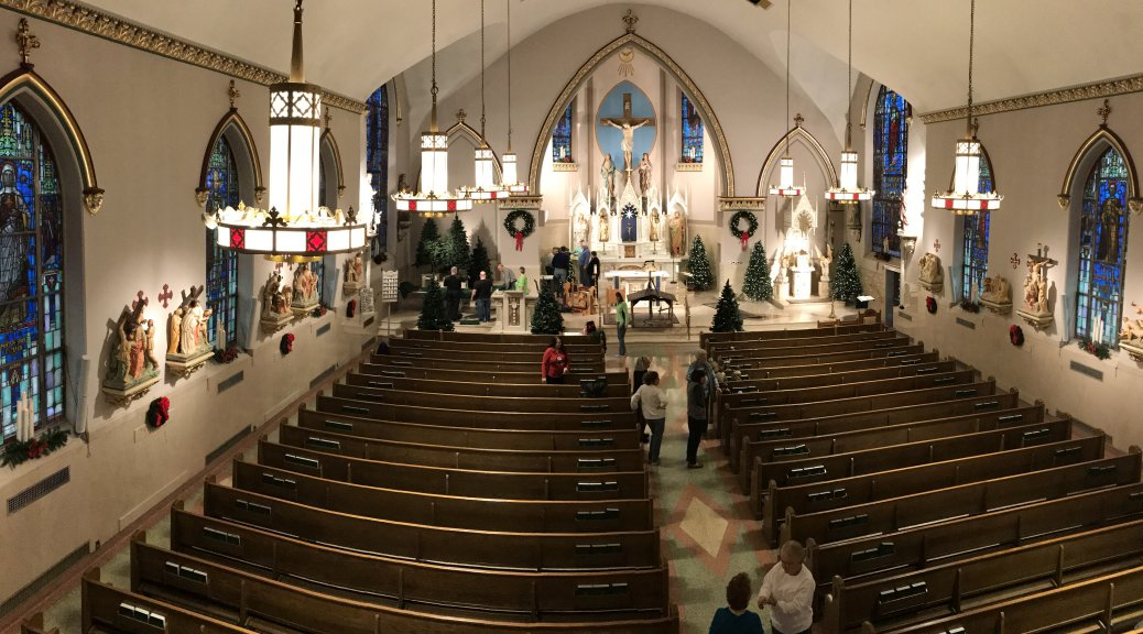 Volunteers decorating the santuary of Incarnation of Our Lord Church, Bethlehem, PA, on Saturda