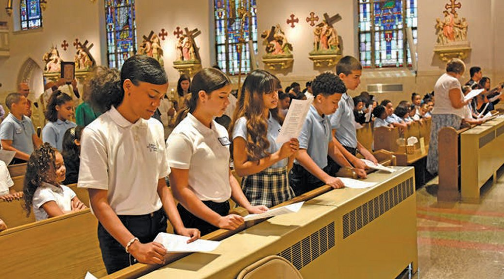 Holy Infancy Students participate in the morning liturgy that preceded the blessing of the school held at Incarnation of Our Lord Church.